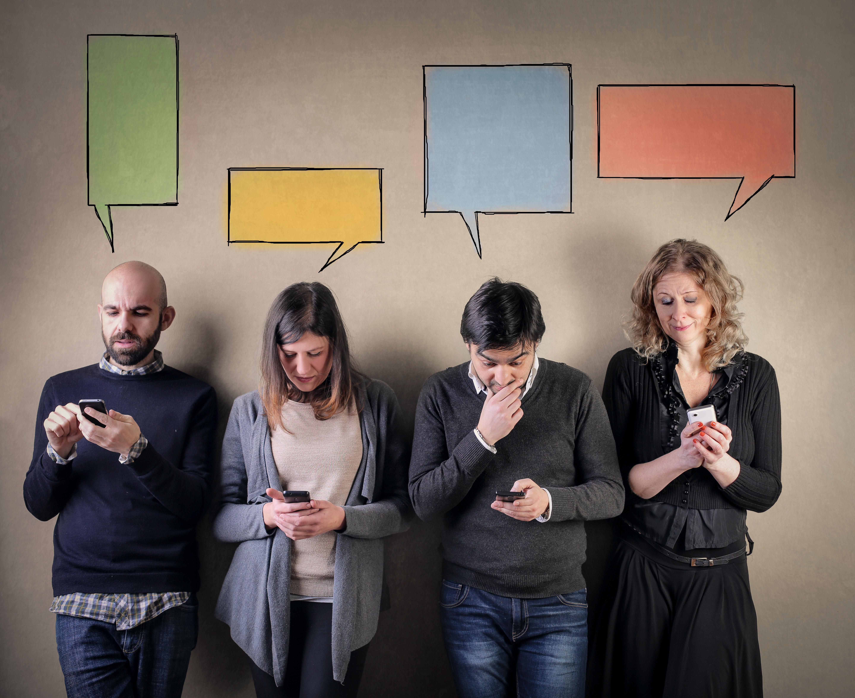 People having a conversation via mobile phones